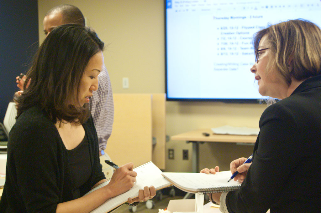 Minna Ng and Gennifer Weisenfeld discuss an activity during the 2015 CIT faculty fellowship