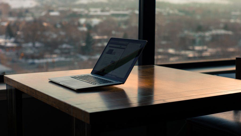 laptop next to window