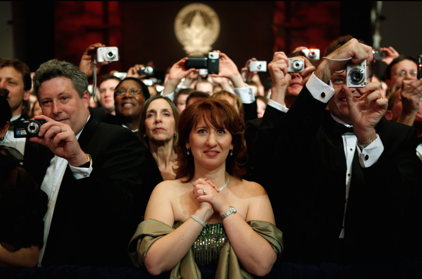 """What's Going on in This Picture?"" featured NY Times image of woman surrounded by a crowd with cameras."