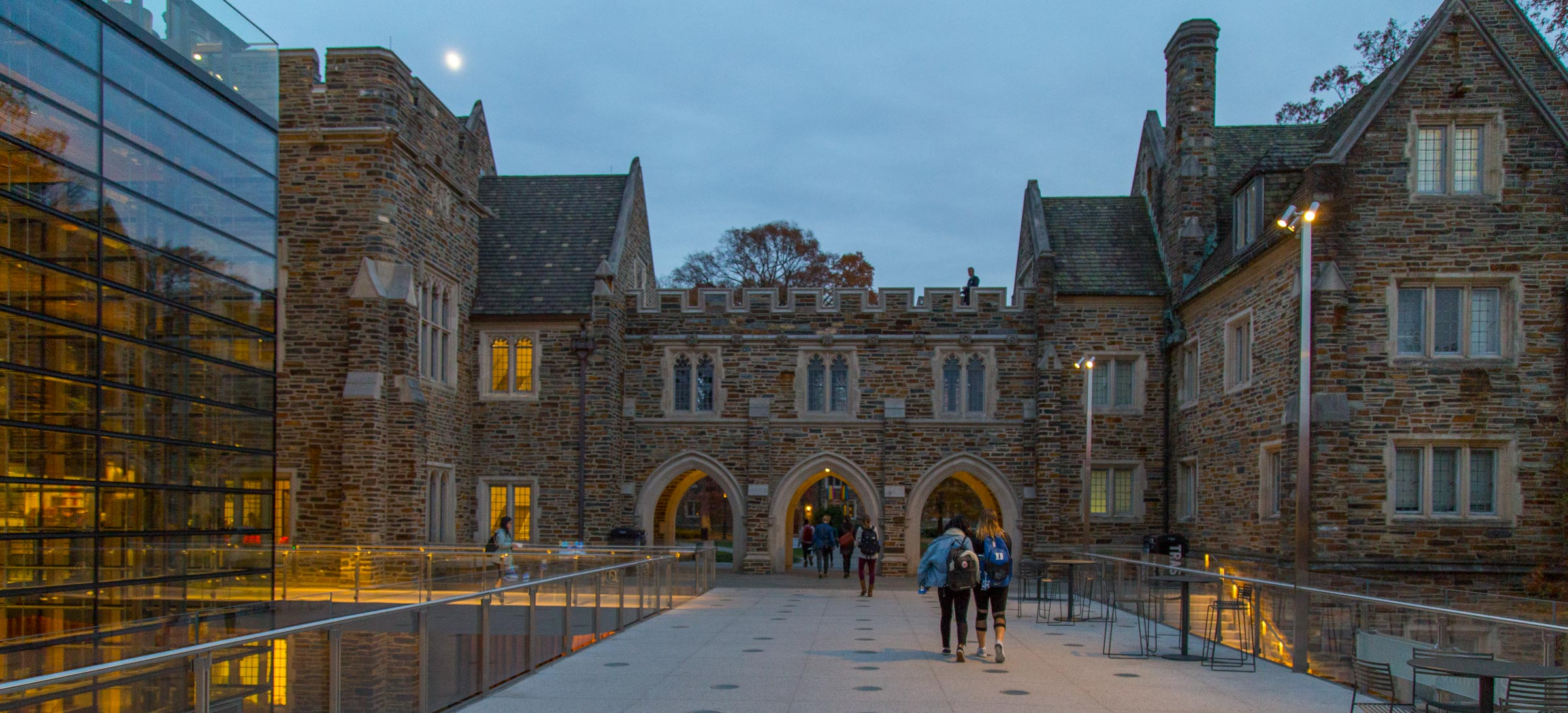 students walking through campus at night