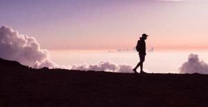 young man hiking on a ridge