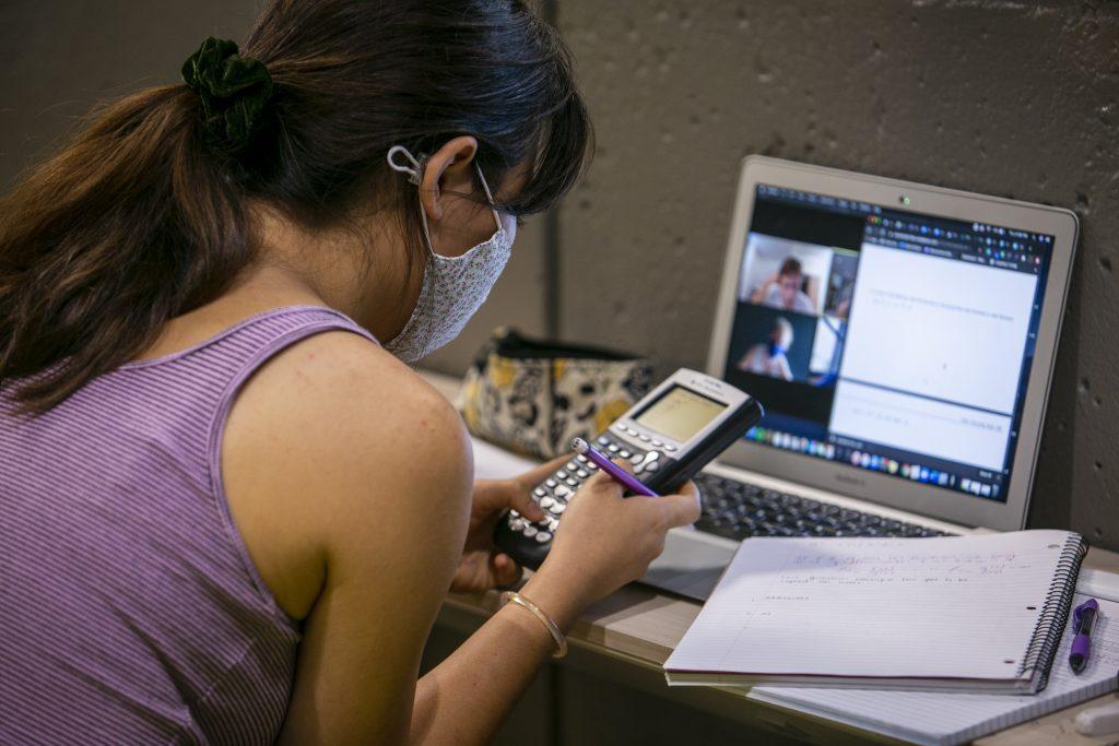 A girl takes an online math class.