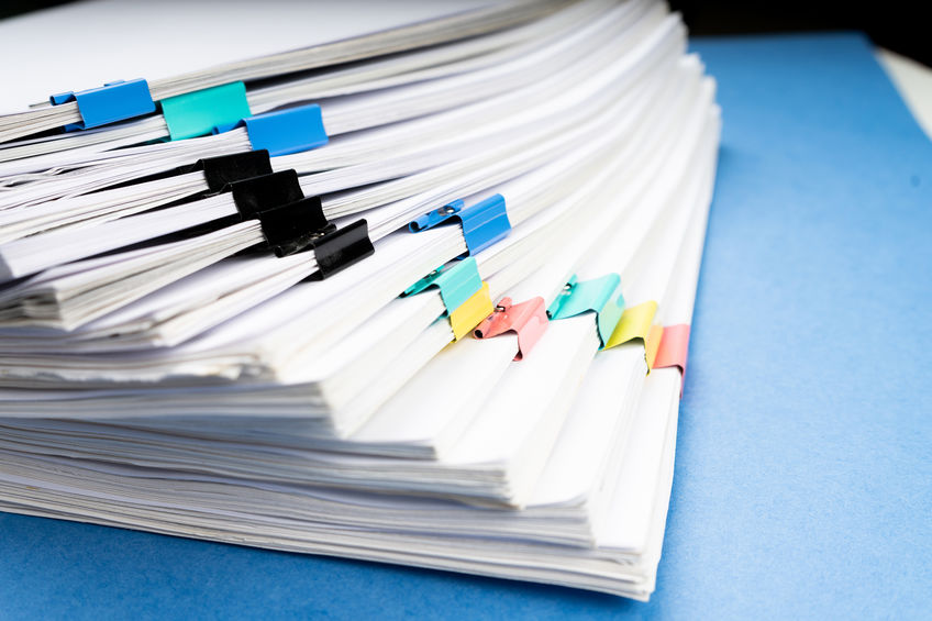 Stack of papers with colorful clips.